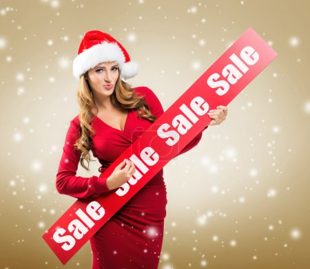 Photo for Santa woman holding board with sale subtitle - Royalty Free Image