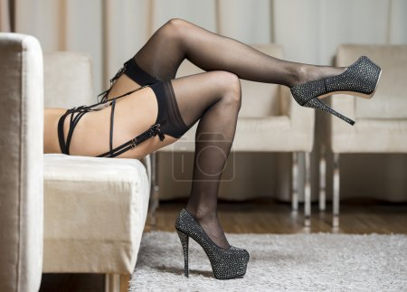 Legs with stockings, garter belt and high heels shoes