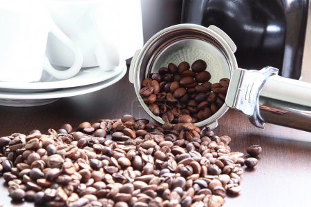Coffee beans in a spoon.