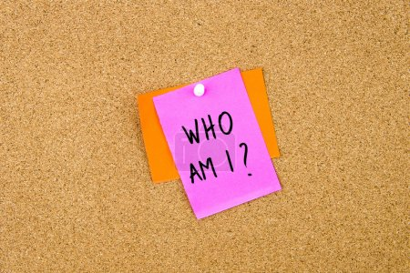 Photo for Who Am I written on paper note pinned on cork board with white thumbtack, copy space available - Royalty Free Image