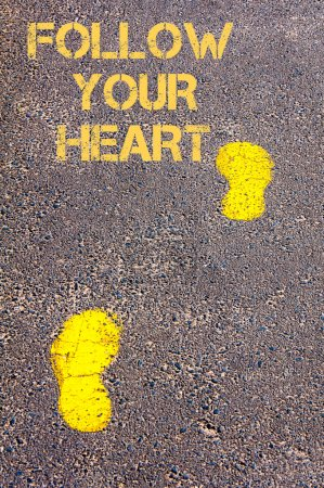 Yellow footsteps on sidewalk towards Follow your heart message