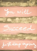 Concept image of You Will succeed, just keep going motivational quote hand written on vintage painted wooden wall