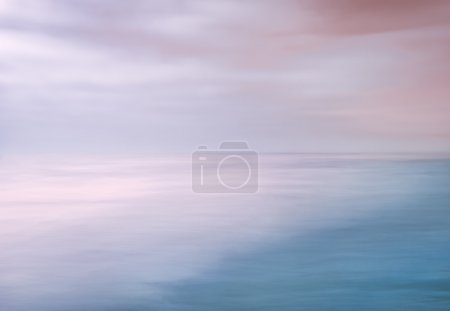 Photo pour A seascape abstract made with panning motion combined with long exposure.  Image displays soft contrast with split-tone colors. - image libre de droit