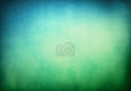 Photo for A textured grunge background with a green to blue gradient.  Image displays significant paper grain and texture when viewed at 100 percent. - Royalty Free Image