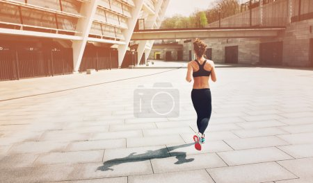 Sport woman.Runner. Running on city