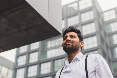 Photo for Portrait of a young handsome Indian man posing in an urban context - Royalty Free Image