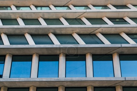 Photo for Architectural detail of a concrete modern building with windows - Royalty Free Image