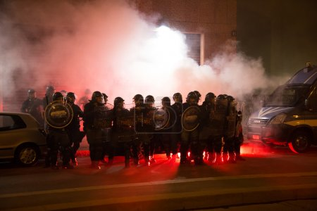 Photo for MILAN, ITALY - OCTOBER 11: Demonstrators launch smoke canisters to police in front of the Turkish consulate while asking help for Kurdish people in Syria on OCTOBER 11, 2014 in Milan. - Royalty Free Image