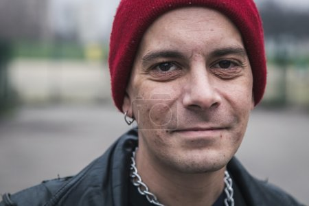 Photo for Punk guy with beanie posing in the city streets - Royalty Free Image