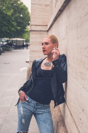 Beautiful girl smoking in the city streets