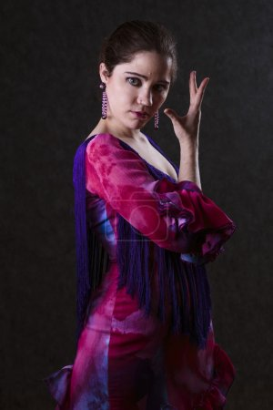 graceful woman in a magenta evening dress
