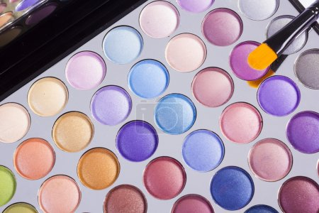 Open compact of colourful eye shadow