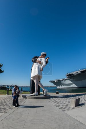 SAN DIEGO, USA - NOVEMBER 14, 2015 - People taking a selfie at sailor and nurse while kissing statue san diego
