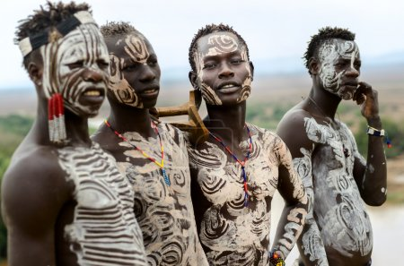 Photo for Kolcho, Ethiopia - August, 12: Unidentified Karo boys near the village of Kolcho, Ethiopia on August 12,2014. Karo tribe people are famouse for their body painting - Royalty Free Image