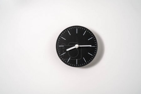 Photo for Close up of an office clock on white background with clipping path - Royalty Free Image