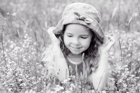 Portrait of a cute little girl on the meadow