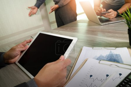 business documents on office table with smart phone and laptop c