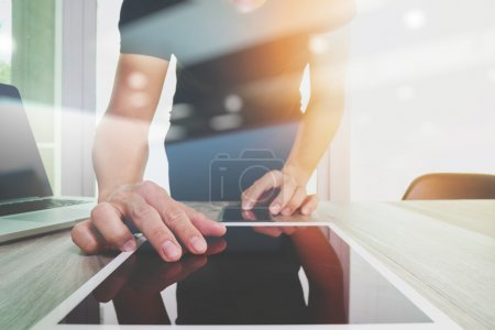 Website designer working digital tablet and computer laptop and
