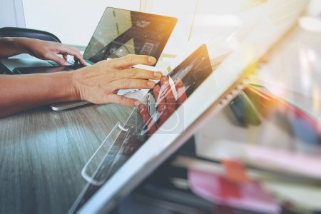 designer hand working with digital tablet and laptop computer an