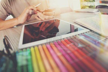 Website designer working digital tablet and computer laptop with