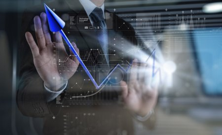 double exposure of businessman hand draws business success chart
