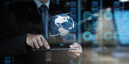 Foto de Doble exposición foto de hombre de negocios mano usando tableta computadora y servidor sala de fondo - Imagen libre de derechos