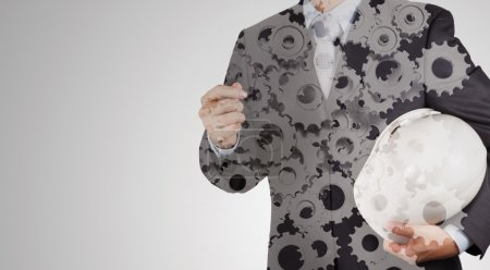 Double exposure of businessman hand with gear to success concept