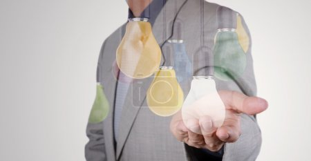Double exposure of Businessman hand working with 3d light bulb o