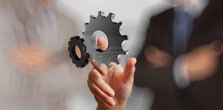 businessman hand showing 3d gear to success concept