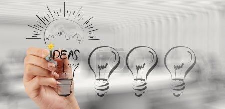 Photo for Hand drawing creative business strategy with light bulb as concept - Royalty Free Image