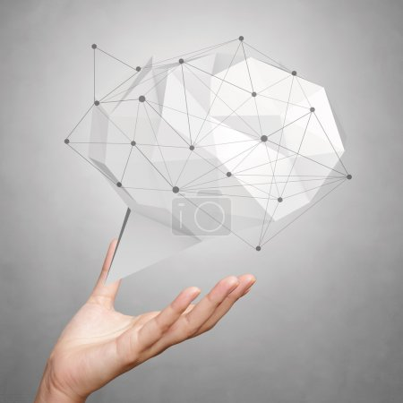 Photo for Hand showing low poly geometric speech bubble with social media structure on white background - Royalty Free Image