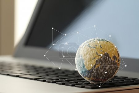 hand drawn texture globe on laptop computer as internet concept