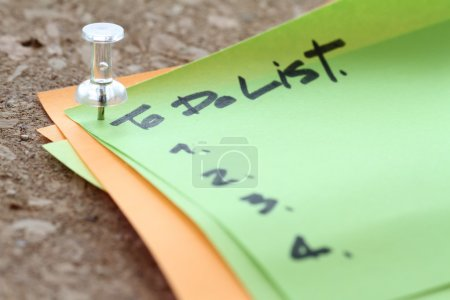 Photo for Close up of pin and to do list word on sticky note with cork board as concept - Royalty Free Image