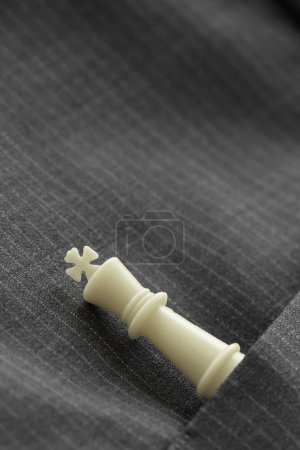 close up of chess figure on suit background strategy or leadersh