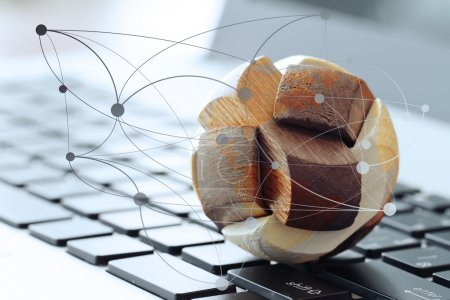 wooden texture globe with social media diagram on laptop compute