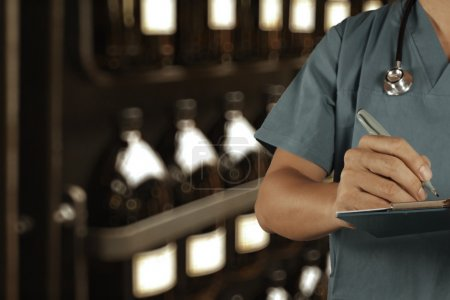 smart doctor working with blurred vintage bottle with bokeh back