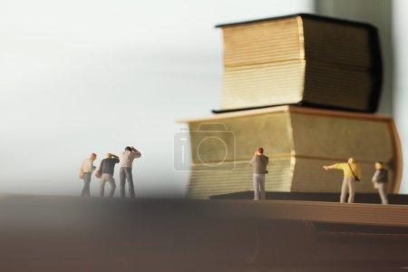 Creative idea concept - miniature photographer with vintage gold