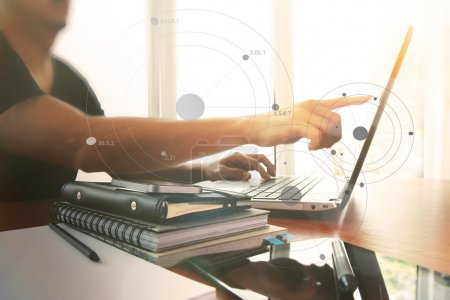 Young creative designer man working at office with computer lapt