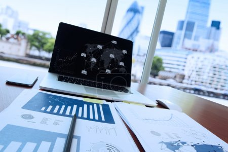 Business documents on office table with pen and digital tablet