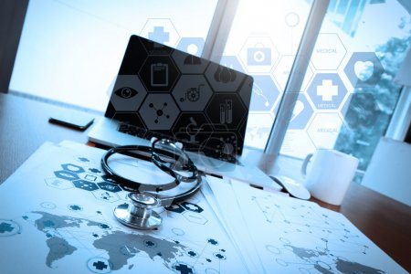 Photo for Doctor workspace with laptop computer in medical workspace office and medical network media diagram as concept - Royalty Free Image