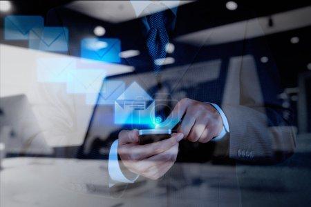 businessman hand use smart phone computer