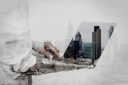 Photo for Double exposure of businessman working on his laptop in office with london city background - Royalty Free Image