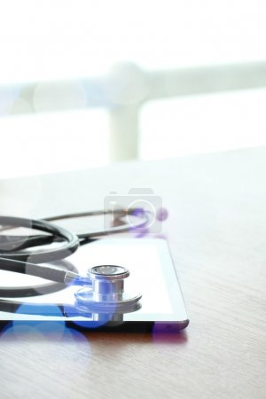 Studio macro of a stethoscope and digital tablet with shallow DO