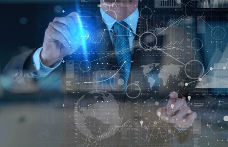 businessman hand working with modern technology and digital laye
