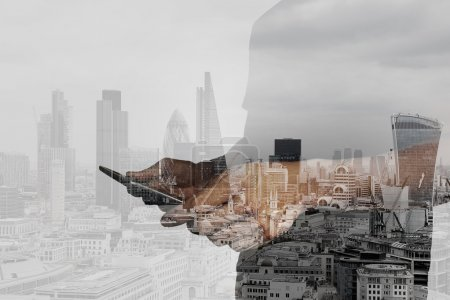Double exposure of success businessman using digital tablet with