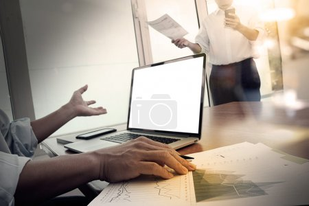 business documents on office table with smart phone and digital