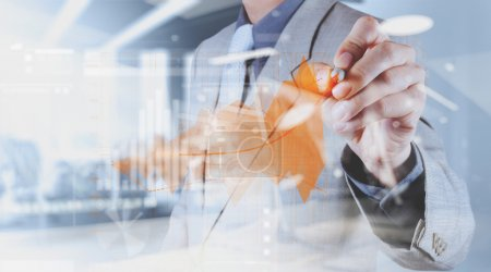 Photo pour Double exposition de la main de l'homme d'affaires travaillant avec un nouvel ordinateur moderne et la stratégie d'entreprise comme concéder - image libre de droit