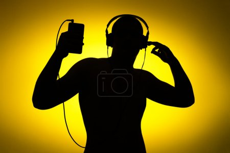 enjoy music, silhouette on yellow