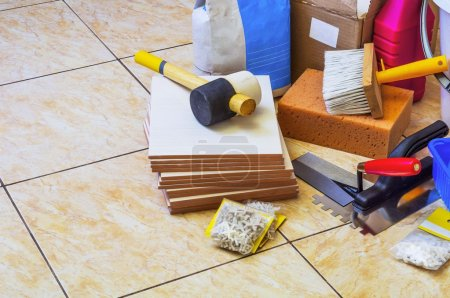 Tools and materials for laying of tile