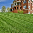 Nice shot of a neatly mowed lawn in front of a pub...